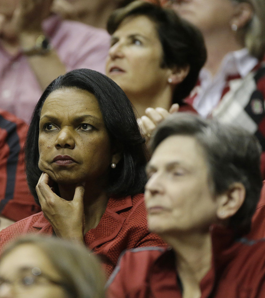 Photo - Former United States Secretary of State Condoleezza Rice watches play between Stanford and Connecticut during the second half of the semifinal game in the Final Four of the NCAA women's college basketball tournament, Sunday, April 6, 2014, in Nashville, Tenn. (AP Photo/Mark Humphrey)