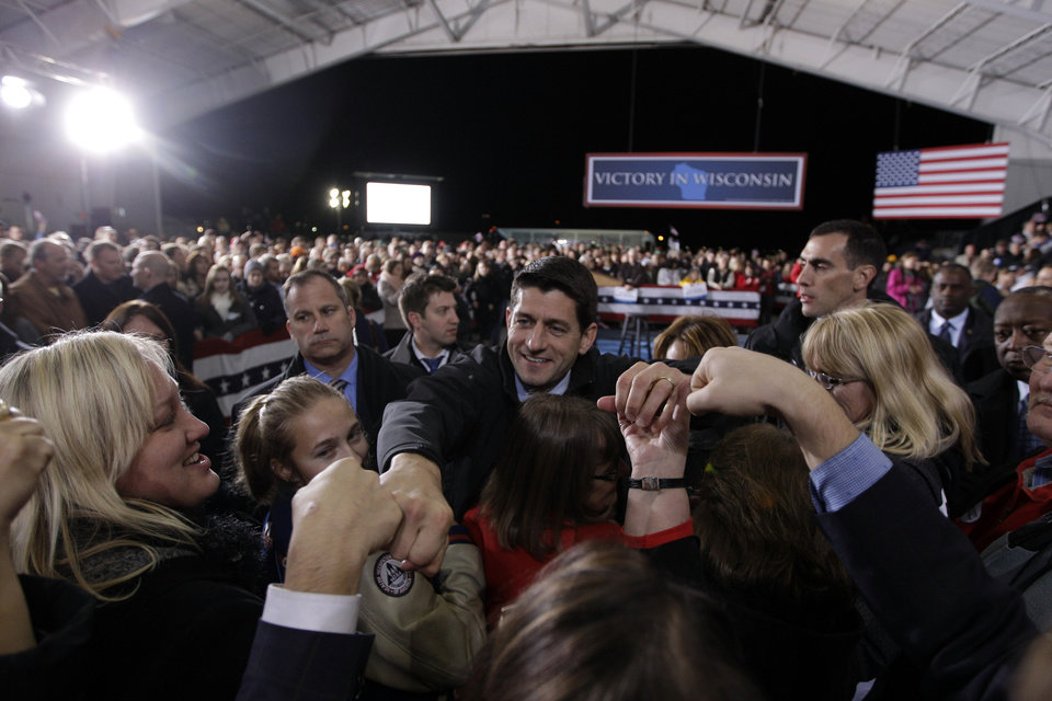 Photo -   Republican vice presidential candidate, Rep. Paul Ryan, R-Wis., fist bumps supporters during a campaign rally in Milwaukee, Wis., Monday, Nov. 5, 2012. (AP Photo/Mary Altaffer)