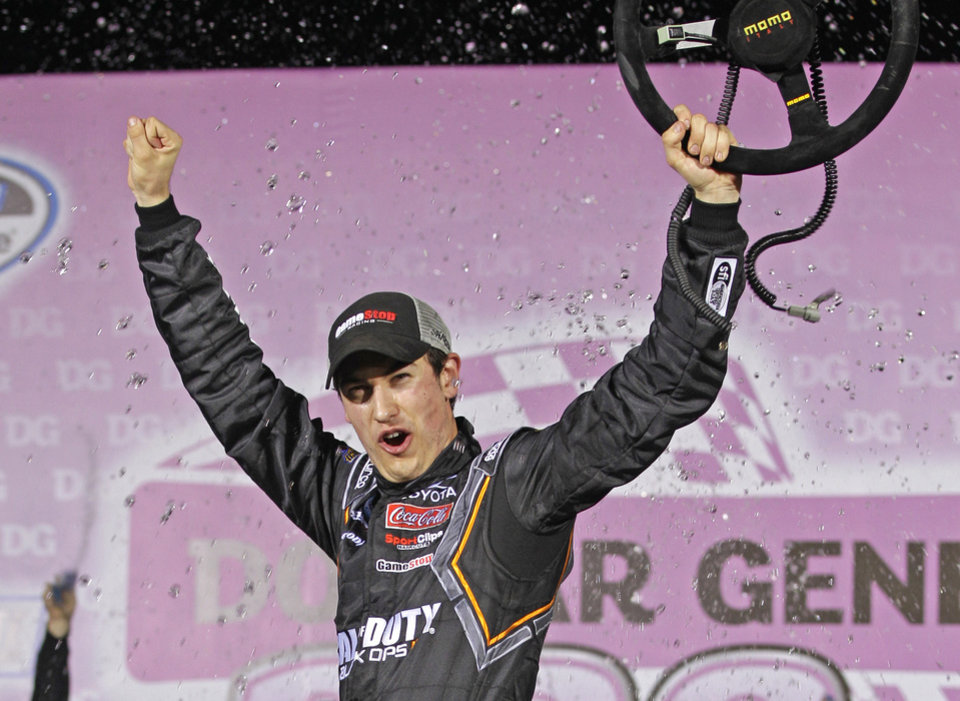 Joey Logano celebrates in victory lane after winning the NASCAR Dollar General 300 Nationwide Series auto race in Concord, N.C., Friday, Oct. 12, 2012. (AP Photo/Chuck Burton)
