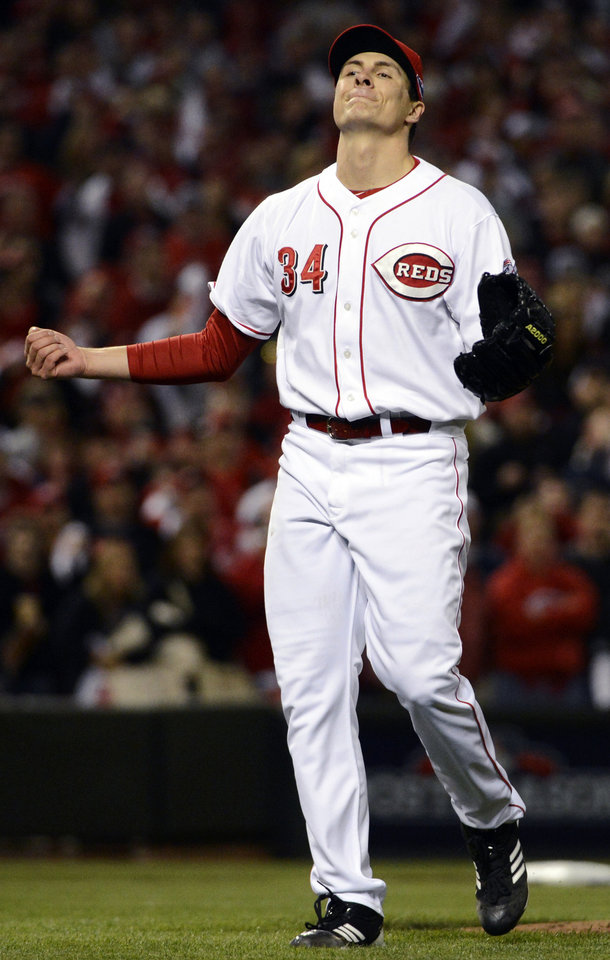 Cincinnati Reds starting pitcher Homer Bailey reacts after giving up the first base hit to San Francisco Giants' Marco Scutaro in the sixth inning during Game 3 of the National League division baseball series, Tuesday, Oct. 9, 2012, in Cincinnati. (AP Photo/Michael Keating)