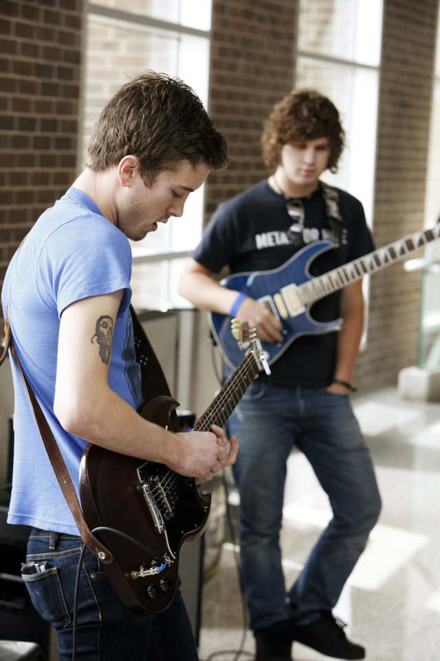 Photo - ACM@UCO student guitarists Joshua Qualls and Dwight Hamlin play guitars during the event.
