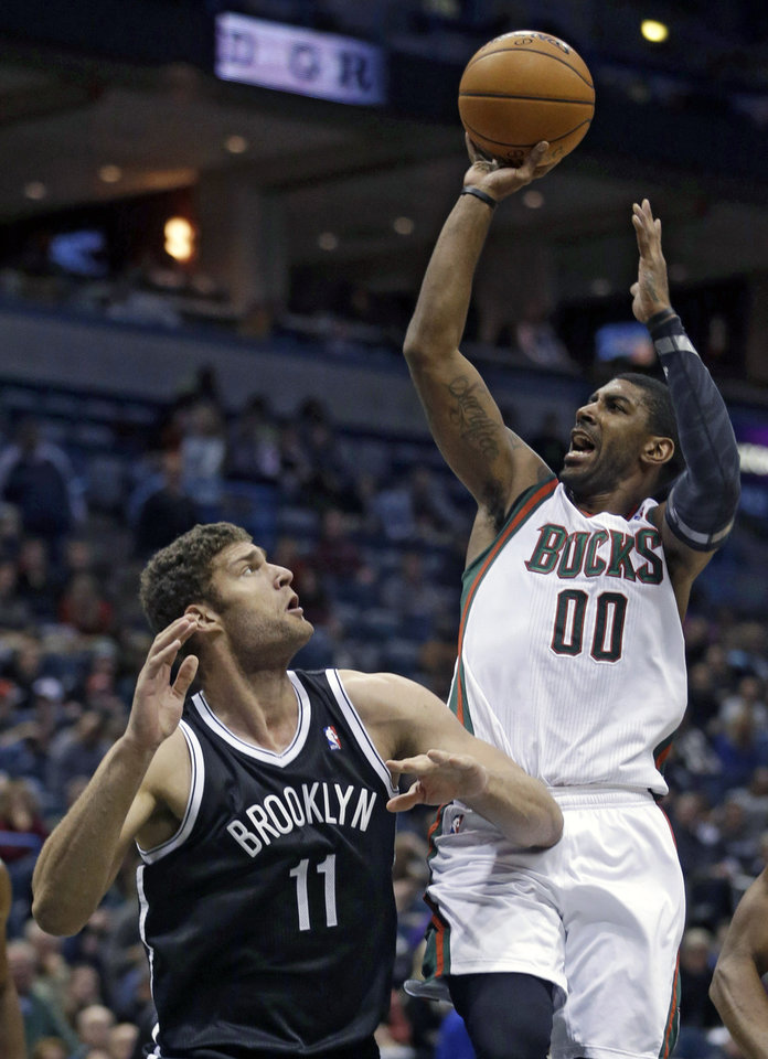 Photo - Milwaukee Bucks' O.J. Mayo shoots over Brooklyn Nets' Brook Lopez during the second half of an NBA basketball game Saturday, Dec. 7, 2013, in Milwaukee. (AP Photo/Morry Gash)