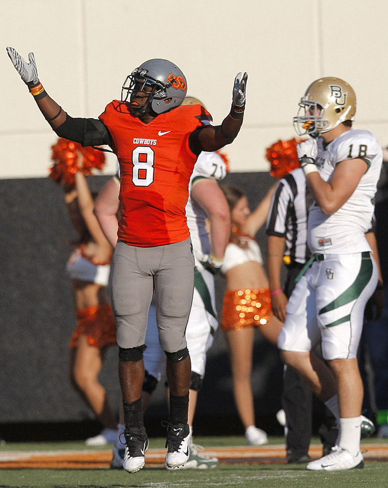 Photo - Oklahoma State's Daytawion Lowe (8) celebrates a turnover in front of Baylor's Jordan Najvar (18) during a college football game between the Oklahoma State University Cowboys (OSU) and the Baylor University Bears (BU) at Boone Pickens Stadium in Stillwater, Okla., Saturday, Oct. 29, 2011. Photo by Sarah Phipps, The Oklahoman