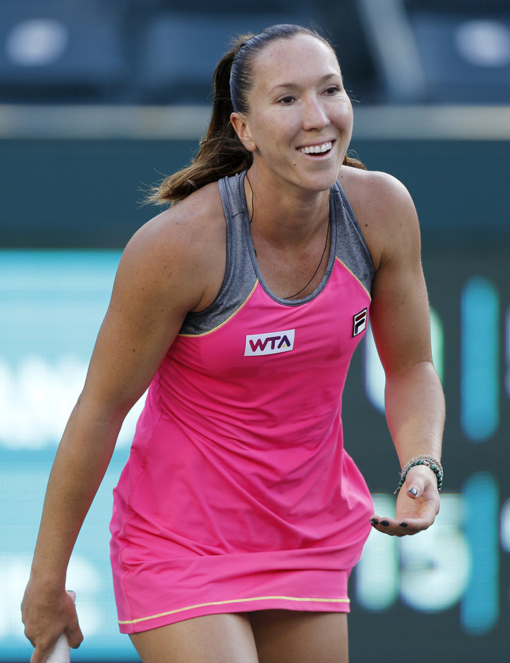 Photo - Jelena Jankovic, of Serbia, smiles during a match against Ajla Tomljanovic, of Croatia, at the Family Circle Cup tennis tournament in Charleston, S.C., Thursday, April 3, 2014. (AP Photo/Mic Smith)
