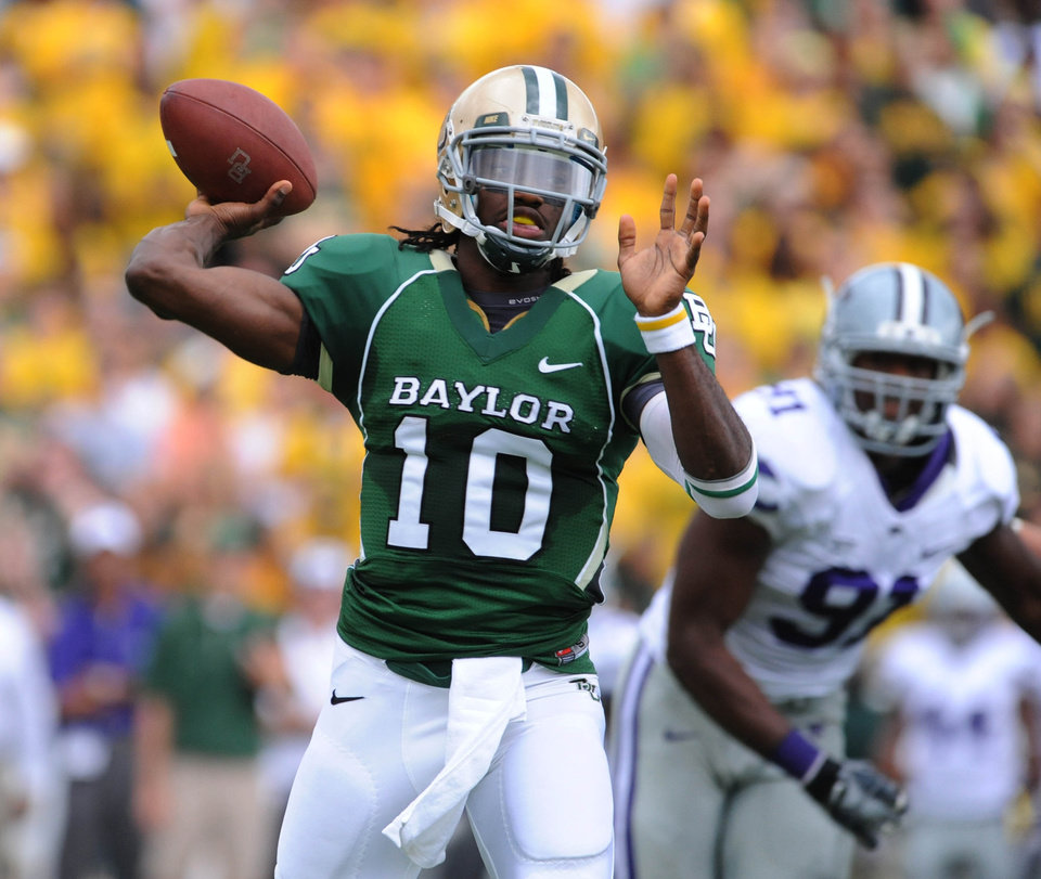 Baylor quarterback Robert Griffin throws past Kansas State  Brandon Harold, right, in the first half of an NCAA football game, Saturday, Oct. 23, 2010 in Waco, Texas. (AP Photo/Waco Tribune Herald, Rod Aydelotte)