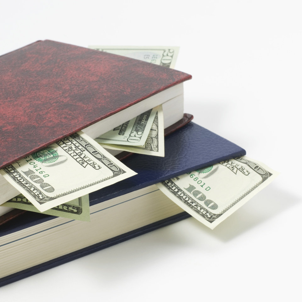 Photo - Stack of books and money