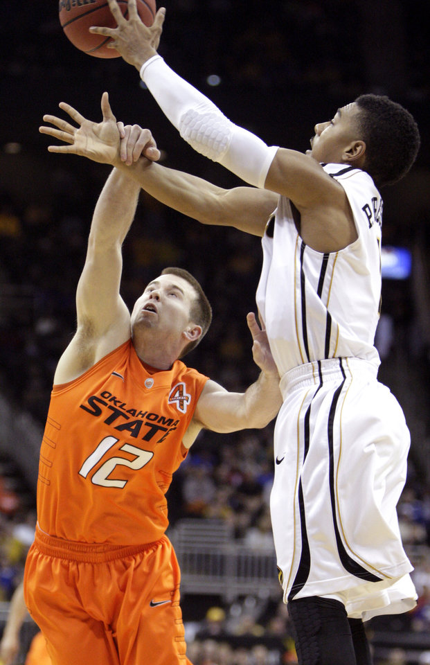 Oklahoma State\'s Keiton Page (12) shot is blocked by Missouri\'s Phil Pressey (1) during the Big 12 tournament men\'s basketball game between the Oklahoma State Cowboys and Missouri Tigers the Sprint Center, Thursday, March 8, 2012. Photo by Sarah Phipps, The Oklahoman