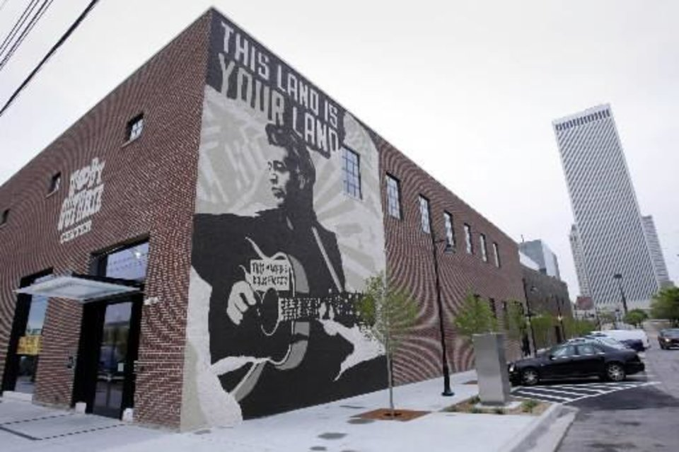 Photo -  What was once an auto part warehouse is now the home of the Woody Guthrie Center at the Guthrie Green Friday, April 26, 2013 in Tulsa, Okla. It took Woody Guthrie's hometown of Okemah more than 30 years after his death to finally celebrate his life and work with an annual music festival, and signs of acknowledgment in other parts of Oklahoma have been rare. The Woody Guthrie Center opens Saturday in Tulsa, it won't mark some uneasy truce between Oklahoma and the Dust Bowl balladeer and his kin. The center's debut will kick off a two-day celebration that affectionately, albeit belatedly, welcomes the native son home with open arms and all the fanfare his longtime supporters can muster. (AP Photo/Tulsa World, Michael Wyke)