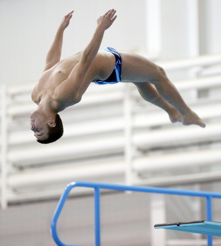 Mark Pontier of Fresno Pacific University competes in men's 3 meter diving preliminaries during the NAIA Swimming and Diving National Championships at Oklahoma City Community College in Oklahoma City, Wednesday, Feb. 29, 2012. . Photo by Nate Billings, The Oklahoman