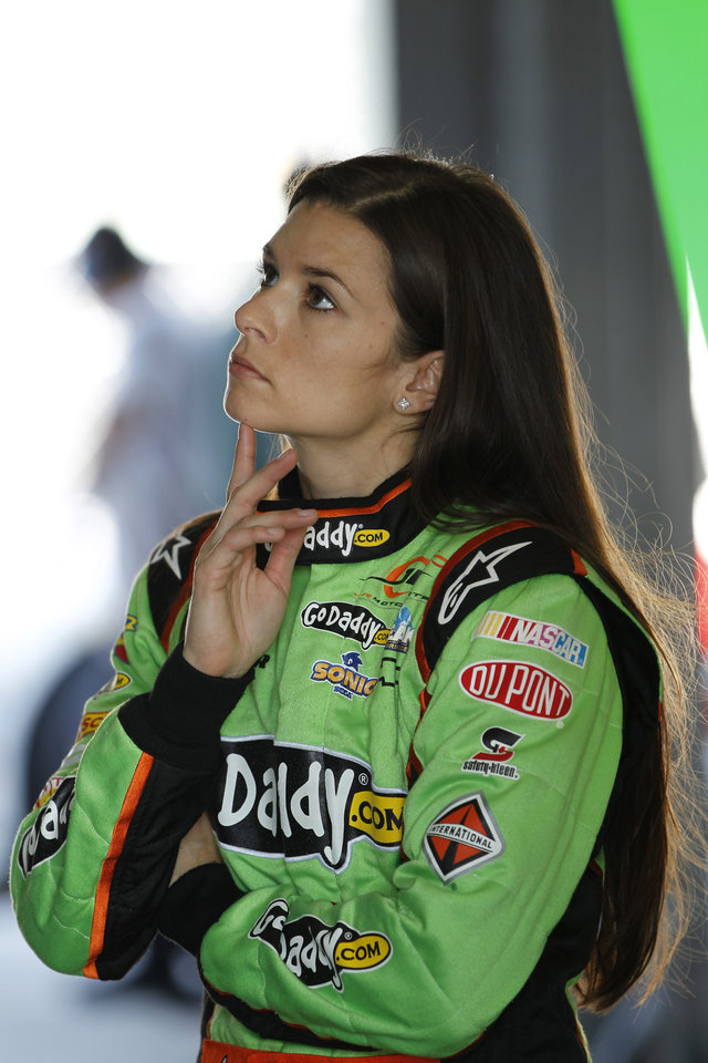 Photo -   Driver Danica Patrick stares at a computer monitor as her team prepares for Saturday's NASCAR Nationwide auto race, Friday, Nov. 16, 2012 at the Miami-Homestead Speedway in Homestead, Fla. (AP Photo/Terry Renna)