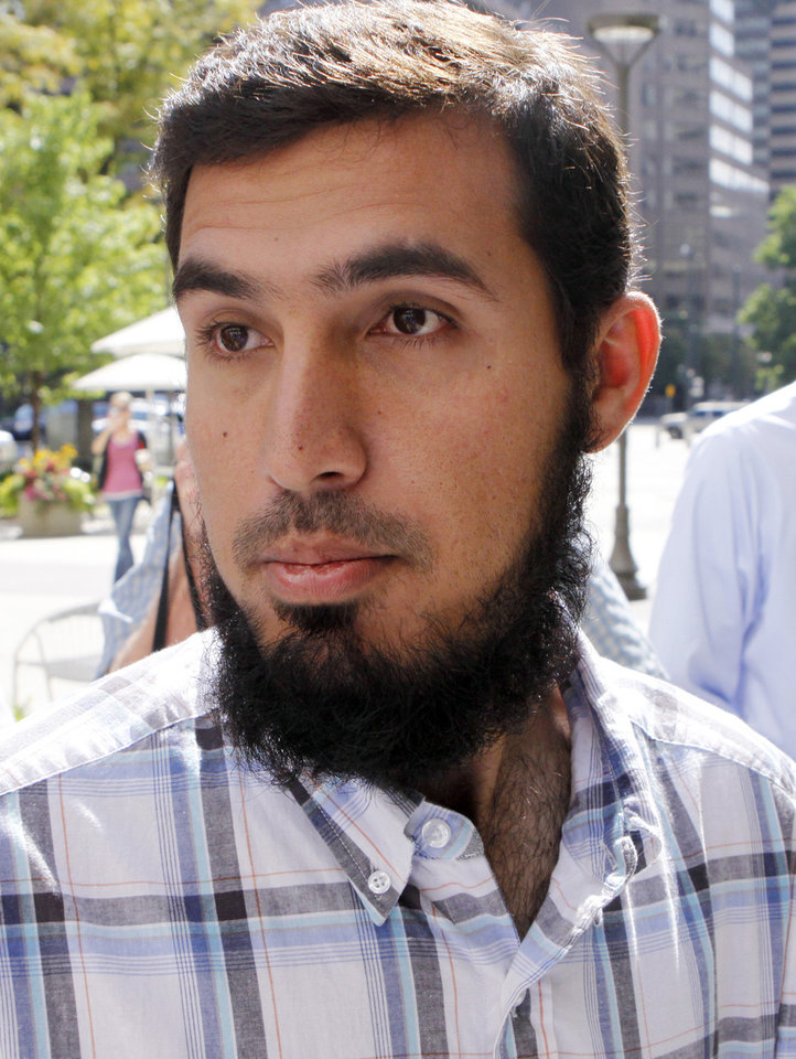 Photo -   FILE - In this Sept. 17, 2009 file photo, Najibullah Zazi, the admitted mastermind of a foiled plot to bomb New York City subways, arrives at the offices of the FBI in Denver for questioning. Zazi on Tuesday April 17, 2012 testified at the trial of his high school classmate Adis Medunjanin, who is on trial on terrorism charges in the Brooklyn borough of New Yorl. Medunjanin is accused of traveling to Pakistan with Zazi and another classmate to seek terror training there so they could launch terror attacks back home. (AP Photo/Ed Andrieski, File)