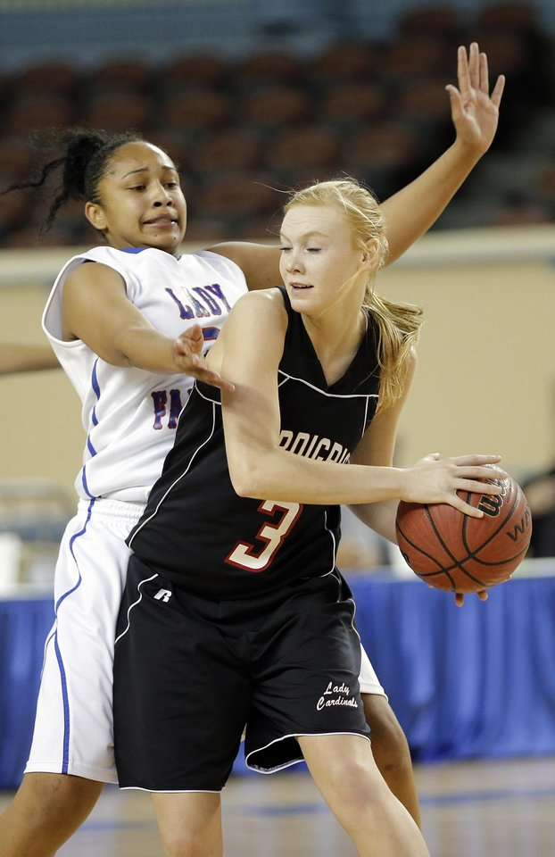 Millwood's Keviona Grissom (3) defends on Verdigris' Stacia Payne (3) during the 3A girls quarterfinals game between Millwood High School and Verdigris High School at the State Fair Arena on Thursday, March 7, 2013, in Oklahoma City, Okla. Photo by Chris Landsberger, The Oklahoman