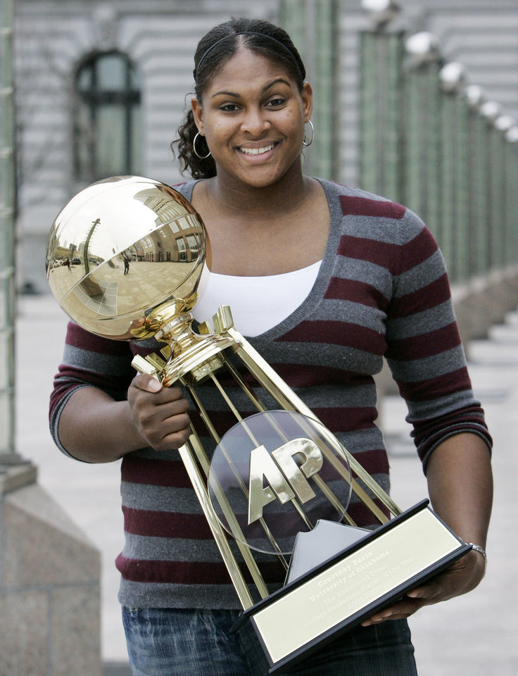 Photo - Oklahoma sophomore Courtney Paris, The Associated Press women's college basketball player of the year, holds her trophy Saturday, March 31, 2007, in Cleveland. (AP Photo/Tony Dejak) ORG XMIT: CD102