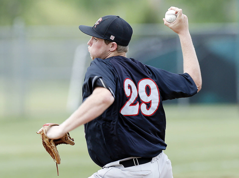 Photo - Carl Albert's Gavin LaValley pitches during the Class 5A state tournament in May. LaValley returns to the Heartland Classic this week on Team Oklahoma with some familiar faces. Photo by Sarah Phipps, The Oklahoman