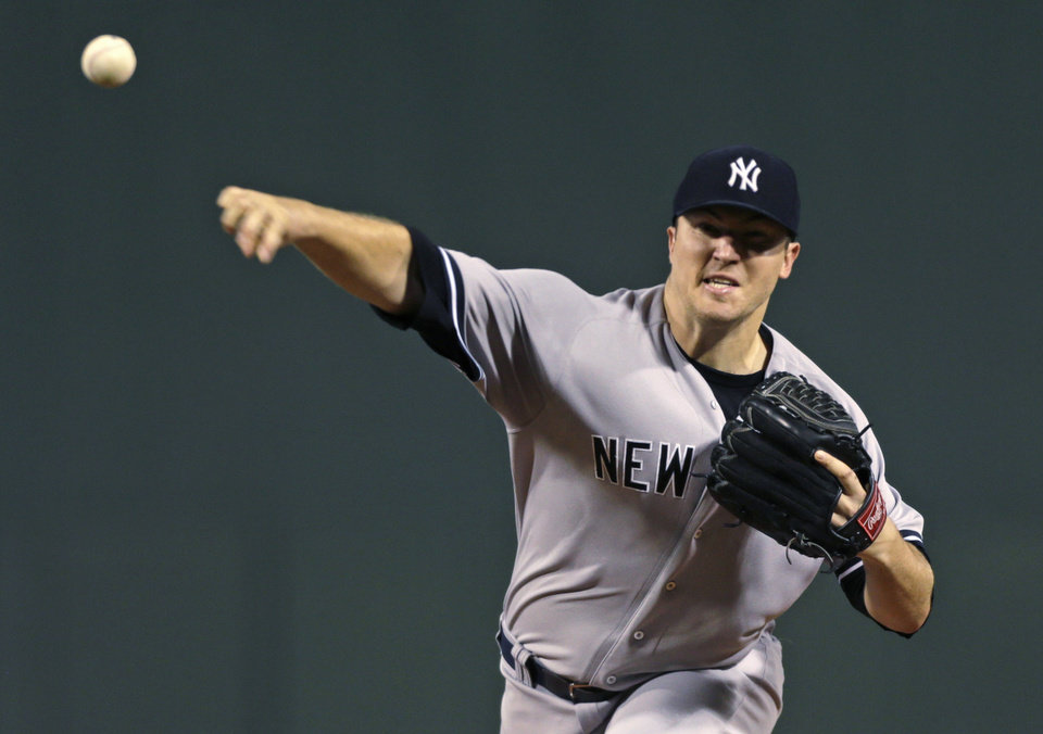 Photo -   New York Yankees starting pitcher Phil Hughes delivers against the Boston Red Sox during the first inning of a baseball game, Thursday, Sept. 13, 2012, at Fenway Park in Boston. (AP Photo/Charles Krupa)