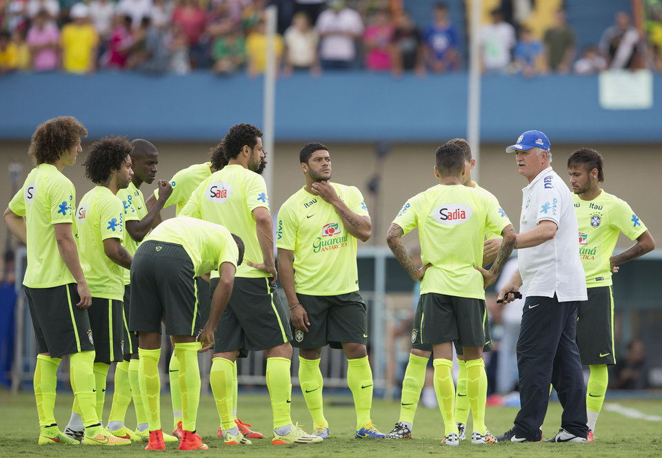 Photo - Brazil's coach Luiz Felipe Scolari gives instructions to his players during a practice session at the Serra Dourada stadium in Goiania, Brazil, Monday, June 2, 2014. Brazil will face Panama on Tuesday in preparation for the World Cup soccer tournament that starts on 12 June. (AP Photo/Andre Penner)