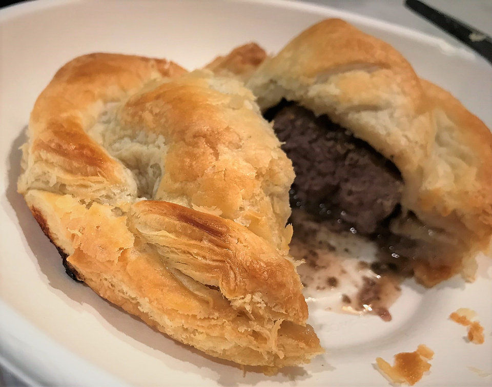 Photo - Beef Wellington puff pastry from Cafe de L'Asie inside The Collective food hall. [Dave Cathey/The Oklahoman]