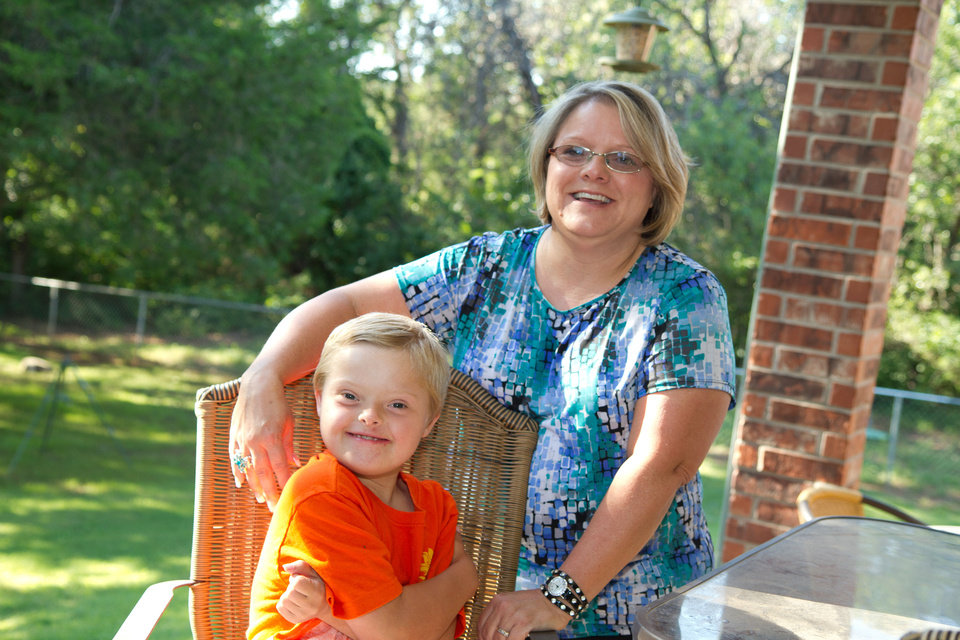 Photo - Lori Wathen and her 9-year-old son, Reis. Photo by Steven Maupin, for The Oklahoman.  Steven Maupin