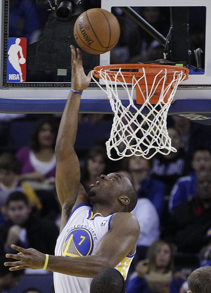 Golden State Warriors\' Carl Landry scores against the during the first half of an NBA basketball game against the Atlanta Hawks Wednesday, Nov. 14, 2012, in Oakland, Calif. (AP Photo/Ben Margot)