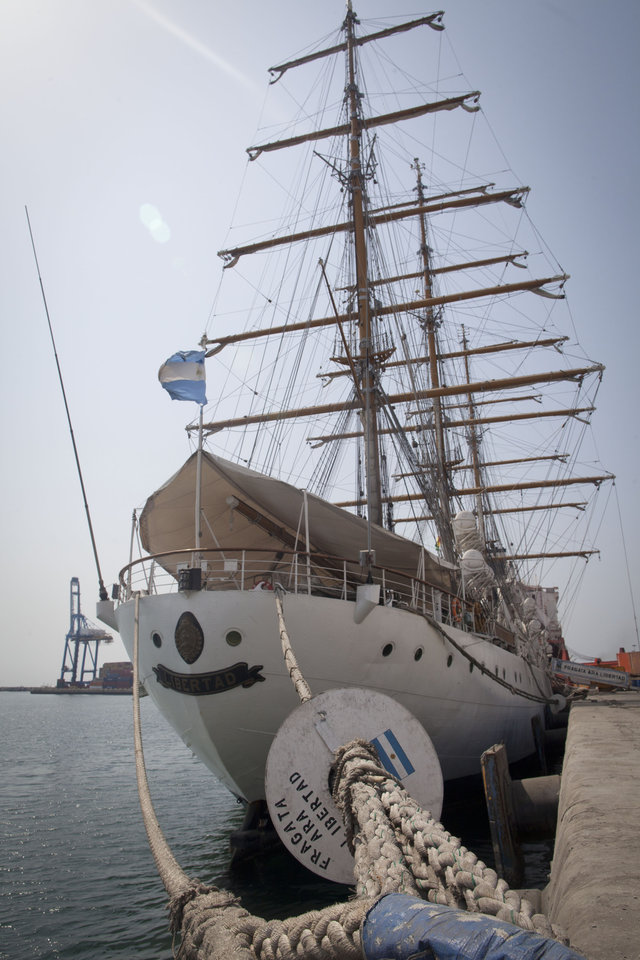 Argentina\'s three-masted navy training tall ship ARA Libertad, which was seized on Oct. 2 as collateral for unpaid bonds dating from Argentina\'s economic crisis a decade ago, sits docked at the port in Tema, outside Accra, in Ghana Friday, Dec. 14, 2012. A U.N. court is expected on Saturday to deliver its order on whether the Argentine navy ship being held at the Ghanaian port should be released. (AP Photo/Gabriela Barnuevo)