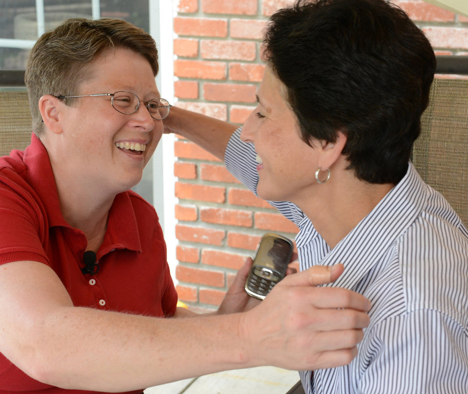 Photo - Deb, left, and Susan Whitewood embrace at their home in South Fayette, Pa., Tuesday, May 20, 2014, after a federal judge overturned the state's ban on gay marriage.  (AP Photo/Pittsburgh Post-Gazette, Bob Donaldson)  MAGS OUT; NO SALES; MONESSEN OUT; KITTANNING OUT; CONNELLSVILLE OUT; GREENSBURG OUT; TARENTUM OUT; NORTH HILLS NEWS RECORD OUT; BUTLER OUT