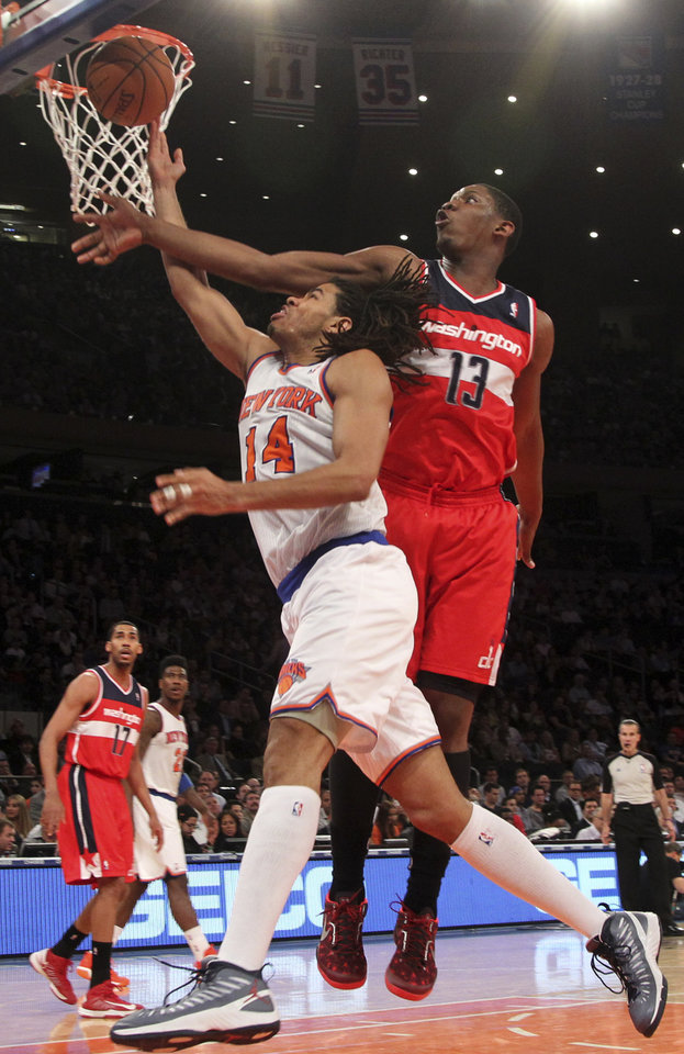 Photo - Washington Wizards' Kevin Seraphin (13) blocks New York Knicks' Chris Copeland from going to the basket during the second half of an NBA basketball game, Tuesday, April 9, 2013, at Madison Square Garden in New York. The Knicks won 120-99. (AP Photo/Mary Altaffer)