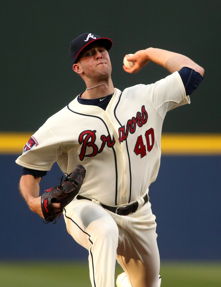 Photo - Atlanta Braves starting pitcher Alex Wood delivers to a Washington Nationals' batter in the first inning of a baseball game on Saturday, April 12, 2014, in Atlanta. (AP Photo/Jason Getz)