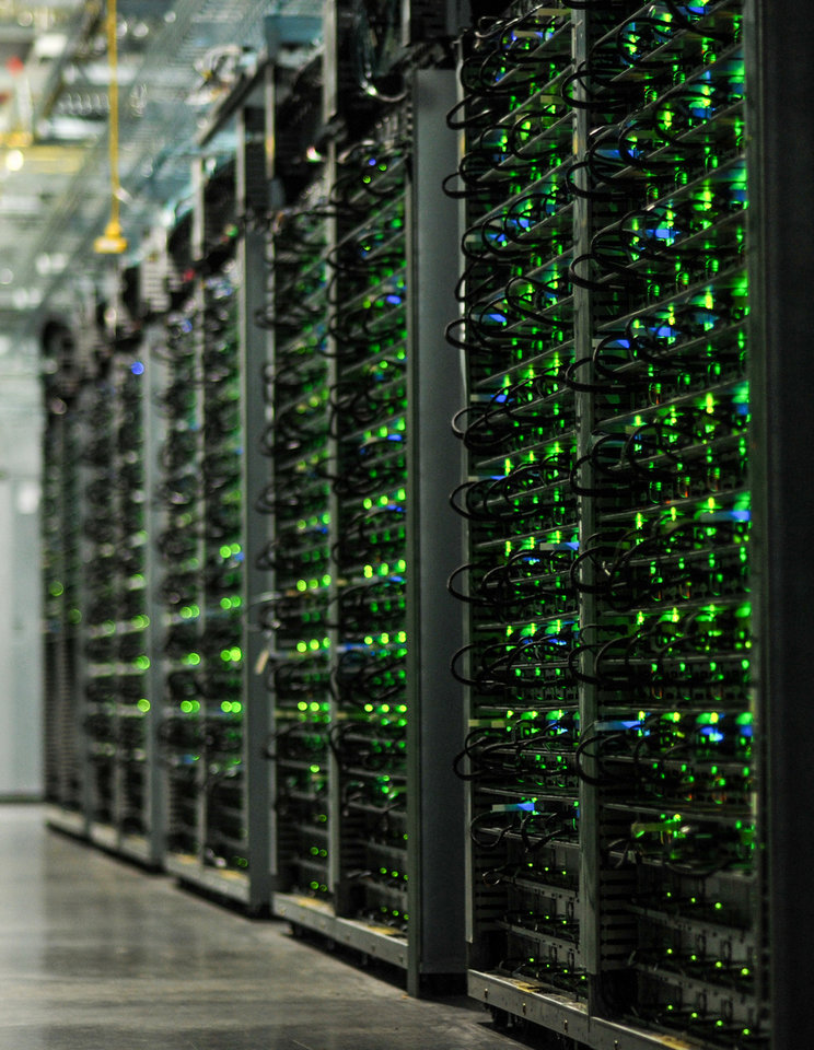 Photo -  Stacks of servers fill a room at Google's data center near Pryor. The internet giant announced Friday that it will spend $600 million to expand the facility. [PHOTO PROVIDED]