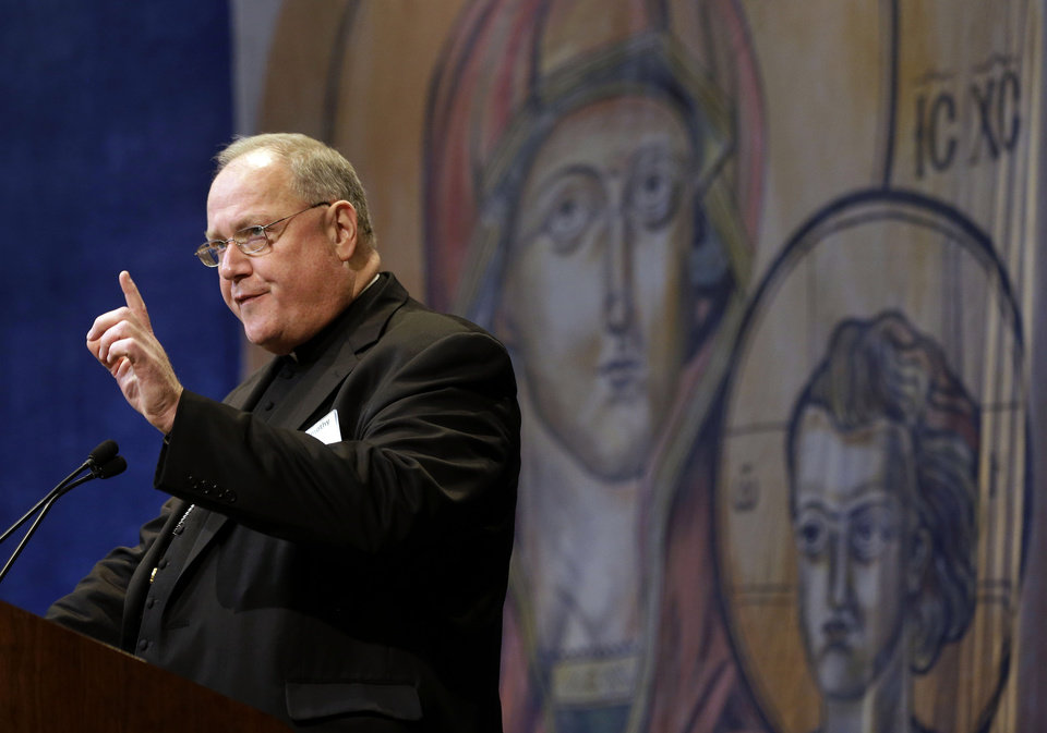 Cardinal Timothy Dolan, of New York, president of the United States Conference of Catholic Bishops, speaks at the conference's annual fall meeting in Baltimore, Monday, Nov. 12, 2012. (AP Photo/Patrick Semansky)