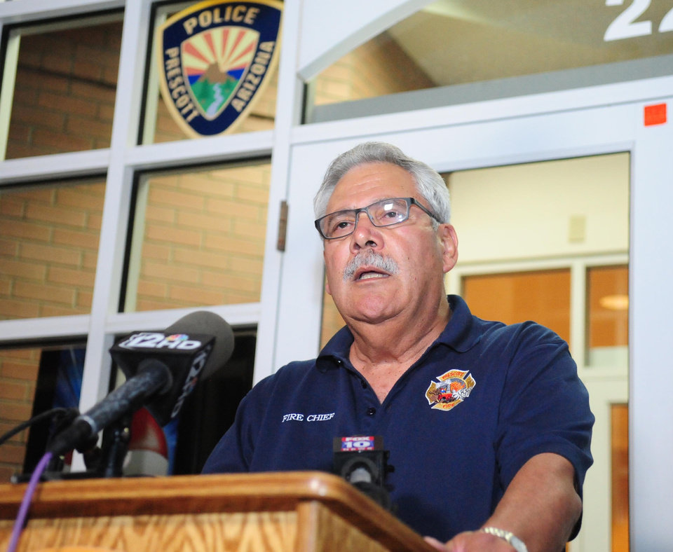 Photo - Prescott Ariz. Fire Chief Dan Fraijo confirms to members of the media that 19 members of the City of Prescott's Granite Mountain Hotshot team died while fighting the Yarnell Hill Fire Sunday, June 30, 2013. (AP Photo/The Daily Courier, Les Stukenberg)