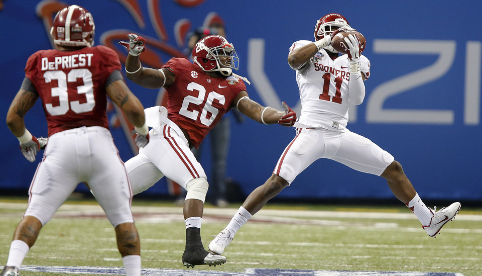 Photo - Oklahoma's Lacoltan Bester (11) makes a touchdown catch in front of Alabama's Landon Collins (26) and Trey DePriest (33) during the NCAA football BCS Sugar Bowl game between the University of Oklahoma Sooners (OU) and the University of Alabama Crimson Tide (UA) at the Superdome in New Orleans, La., Thursday, Jan. 2, 2014.  .Photo by Chris Landsberger, The Oklahoman