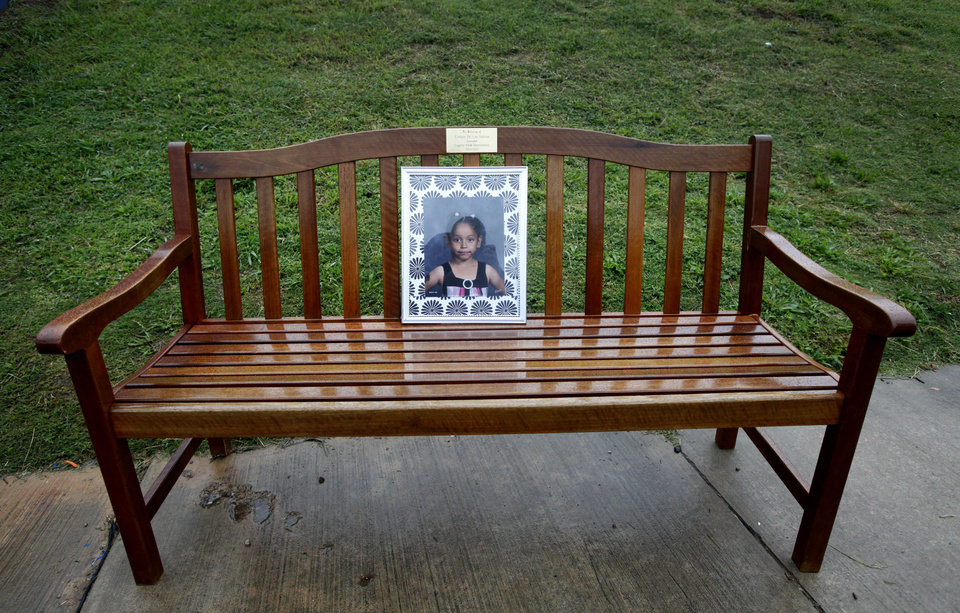 Photo - A bench with Evelyn De Los Santos' name and photo is shown at Eugene Field Elementary School.