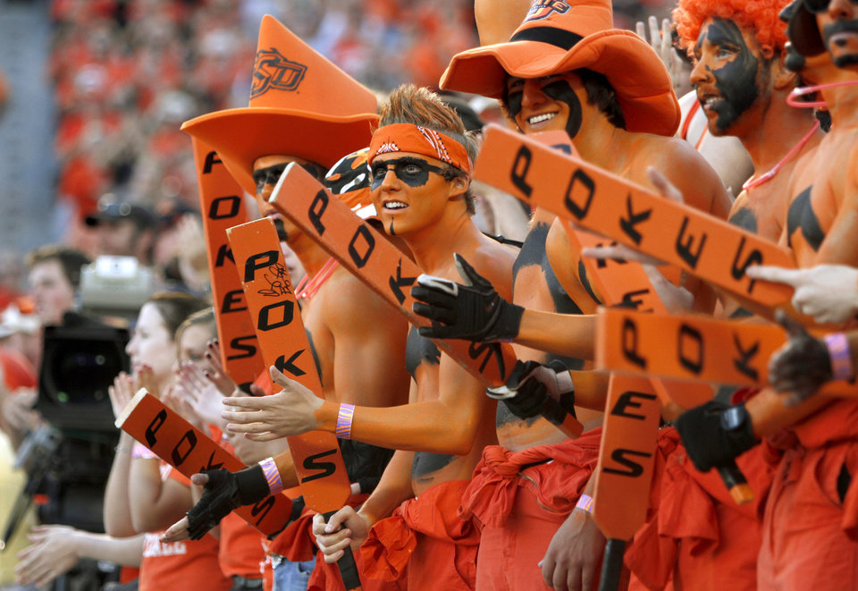 Photo - Fans dressed in Oklahoma State colors cheer during the college football game between Texas A&M University and Oklahoma State University (OSU) at Boone Pickens Stadium in Stillwater, Okla., Thursday, Sept. 30, 2010. Photo by Bryan Terry, The Oklahoman