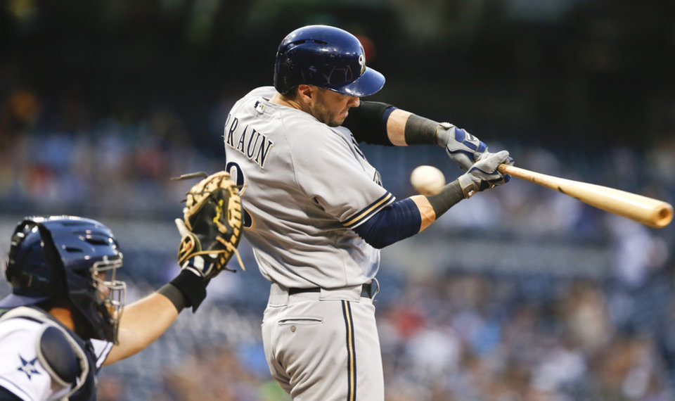 Photo - Milwaukee Brewers' Ryan Braun swings and misses while chasing a high inside pitch in the first inning of a baseball game against the San Diego Padres on Tuesday, Aug. 26, 2014, in San Diego. Braun struck out in his first two at-bats.   (AP Photo/Lenny Ignelzi)