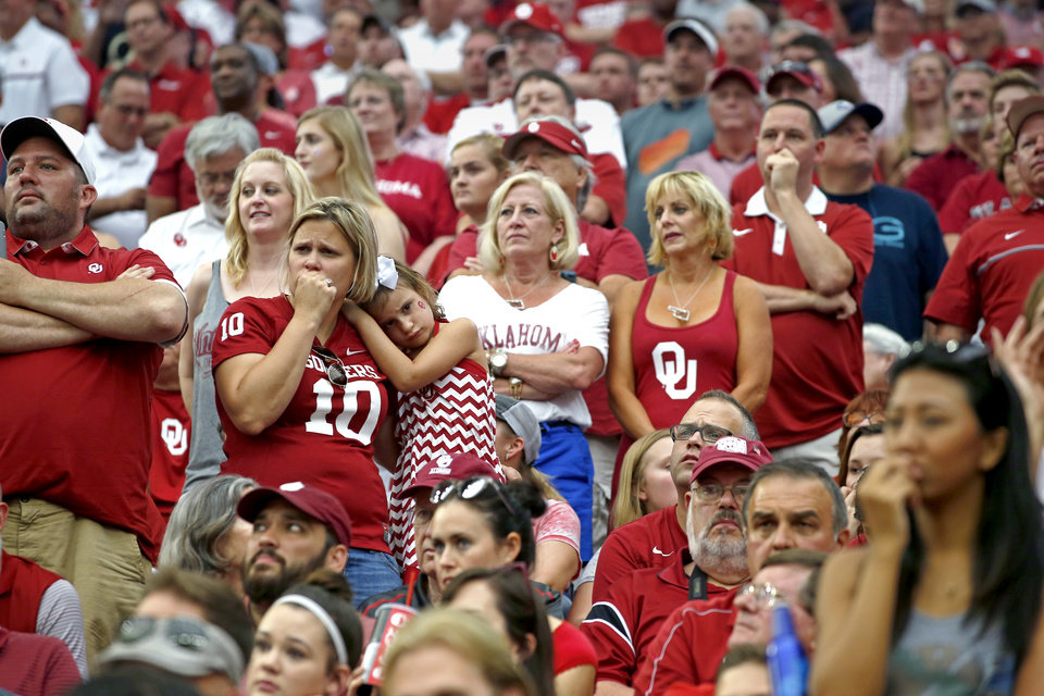 Photo - Oklahoma fans watch during the AdvoCare Texas Kickoff college football game between the University of Oklahoma Sooners (OU) and the Houston Cougars at NRG Stadium in Houston, Saturday, Sept. 3, 2016. Houston won 33-23. Photo by Bryan Terry, The Oklahoman