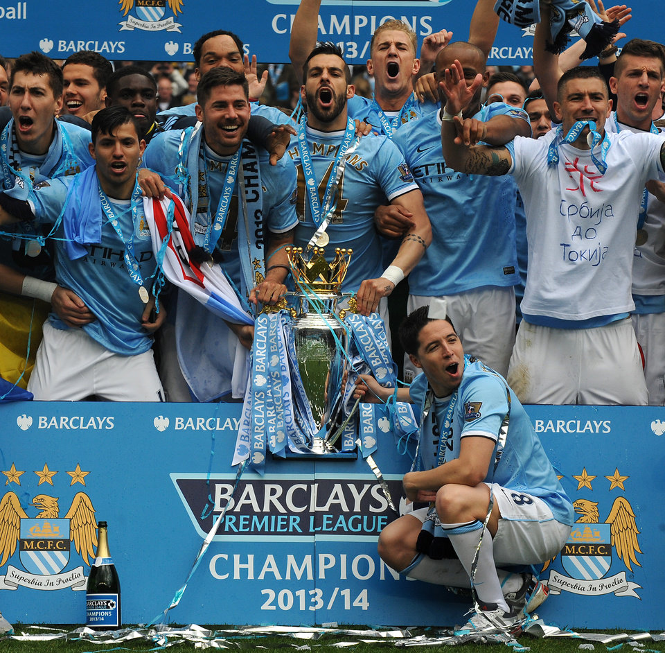 Photo - Manchester City's players celebrate after being crowned Champions after the English Premier League soccer match between Manchester City and West Ham United at the Etihad Stadium,  Manchester, England, Sunday, May 11, 2014. (AP Photo/Rui Vieira)