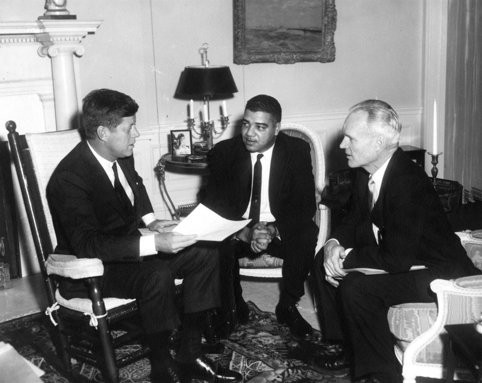 "This photo provided by the Kennedy Library, show eting with National Urban League officials. President Kennedy (in rocking chair) meeting with National Urban League Executive Director Whitney M. Young, center, and president Henry Steeger in the president\'s Living Room of the White House in Washington, on Jan. 23, 1962. Rep. John Lewis, D-Ga., tells the story of Young's boldness in dealing with civil rights issues in ""The Powerbroker: Whitney Young's Fight For Civil Rights"" a documentary airing during Black History Month on PBS' Independent Lens and shown in some community theaters. (AP Photo/The White House, Abbie Rowe, John F. Kennedy Presidential Library and Museum)"