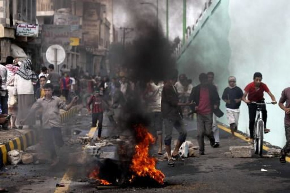 Photo - Protesters run as police, unseen, open fire into the air near the U.S. Embassy during a protest about a film ridiculing Islam's Prophet Muhammad, in Sanaa, Yemen, Thursday, Sept. 13, 2012. Yemen's president has apologized to President Barack Obama for the attack on the U.S. Embassy in Sanaa, the Yemeni capital, by a mob angry over an anti-Islam film. (AP Photo/Hani Mohammed)