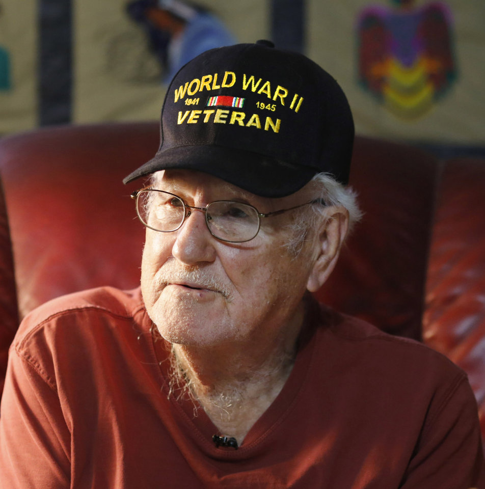Photo -  Roy Wright, 91, of northwest Oklahoma City, is a U.S. Navy veteran who served aboard the aircraft carrier USS Enterprise during World Ward II. [Photo by Jim Beckel, The Oklahoman]