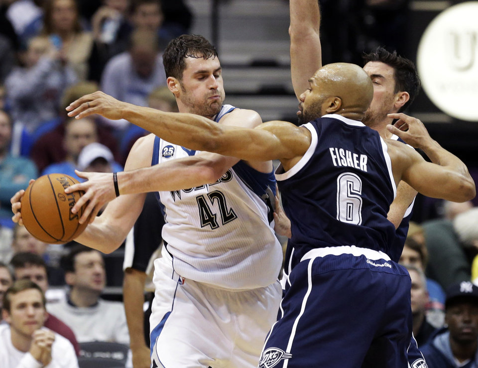Photo - Minnesota Timberwolves' Kevin Love, left, keeps the ball away from Oklahoma City Thunder's Derek Fisher (6) and Steven Adams during the second half of an NBA basketball game Saturday, Jan. 4, 2014, in Minneapolis. The Thunder won 115-111. (AP Photo/Jim Mone)