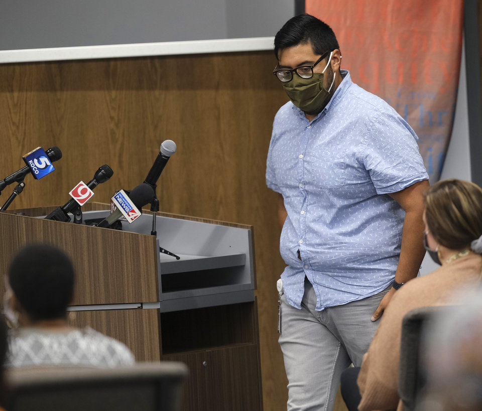 Photo - Marten Ortiz looks at his wife, Tanzi Ortiz, as he leaves the podium at the first live Oklahoma City School Board meeting in the new Clara Luper Center for Educational Services, Monday, November 9, 2020. [Doug Hoke/The Oklahoman]
