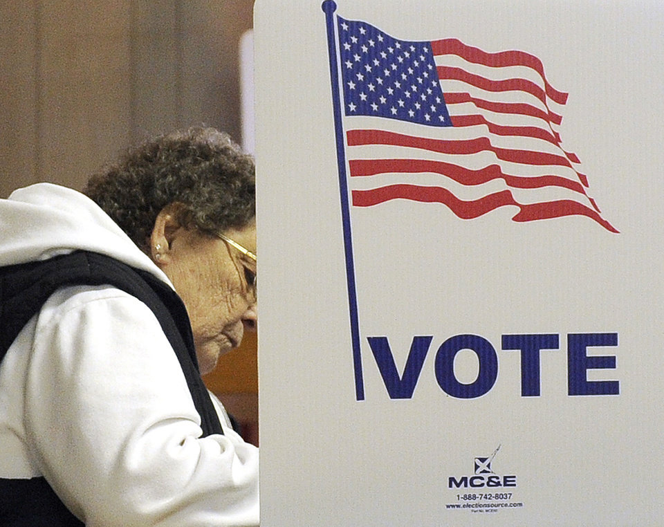 Gerry Smith of Minnesota City, Minn., casts her vote Tuesday, Nov. 6, 2012, at the Minnesota City City Hall. After a grinding presidential campaign, Americans are heading into polling places across the country. (AP Photo/Winona Daily News, Andrew Link)