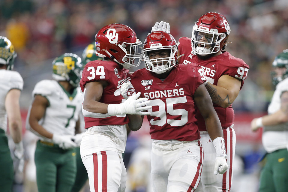 Photo - Oklahoma's David Ugwoegbu (34) ), Isaiah Thomas (95) and Marquise Overton (97) during the Big 12 Championship Game between the University of Oklahoma Sooners (OU) and the Baylor University Bears at AT&T Stadium in Arlington, Texas, Saturday, Dec. 7, 2019. Oklahoma won 30-23. [Bryan Terry/The Oklahoman]