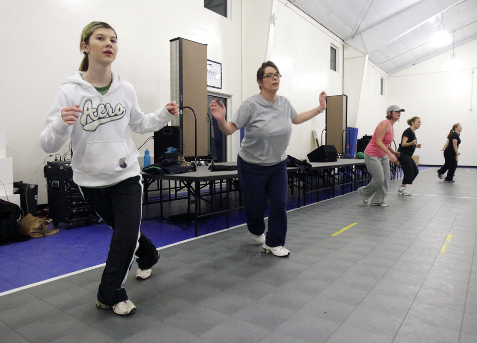 Photo - EXERCISE / AMANDA KNIGHT: Lexi Knight (left) and her mother Amanda participate in a New Year's Boot Camp at the Holy Trinity Lutheran Church in Edmond, OK, Saturday, Jan. 2, 2010. By Paul Hellstern, The Oklahoman ORG XMIT: KOD