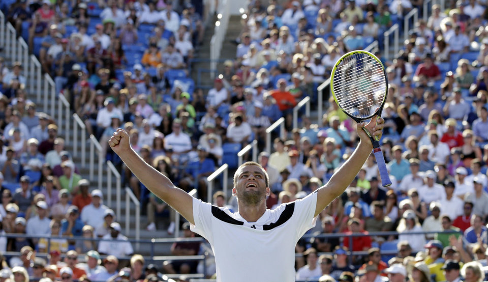 Photo - Mikhail Youzhny, of Russia, reacts after defeating Lleyton Hewitt, of Australia, during the fourth round of the 2013 U.S. Open tennis tournament, Tuesday, Sept. 3, 2013, in New York. (AP Photo/Kathy Willens)