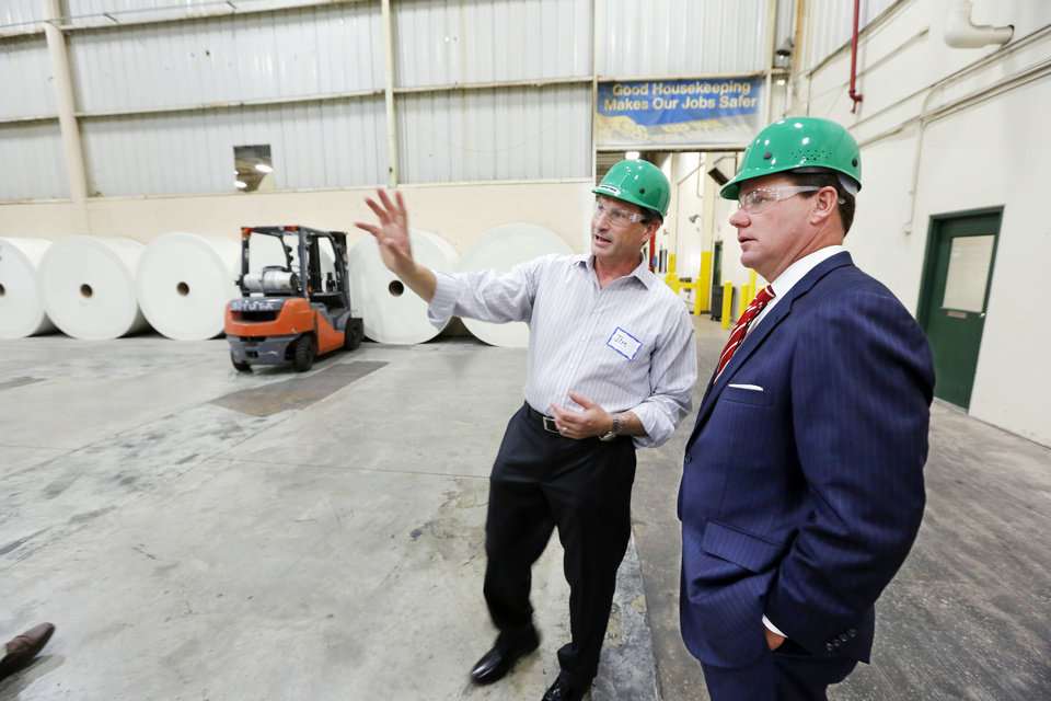 Photo - Malarkey Roofing Products CEO Jim Fagan gives Lt. Gov. Todd Lamb a tour of the production plant in Oklahoma City Friday as part of National Manufacturing Day.  Steve Gooch - The Oklahoman