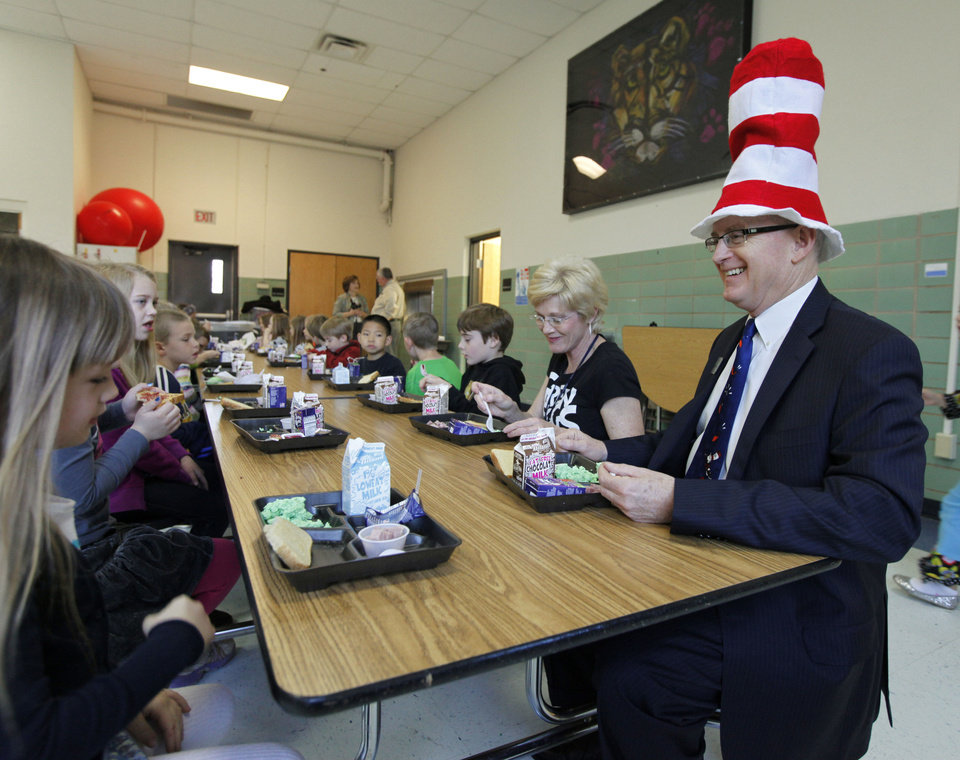 Edmond Public Schools Superintendent David Goin eats green eggs and ham with first-graders at Clegern Elementary School in honor of Dr. Seuss' birthday. PHOTO BY PAUL HELLSTERN, THE OKLAHOMAN. <strong>PAUL HELLSTERN - Oklahoman</strong>