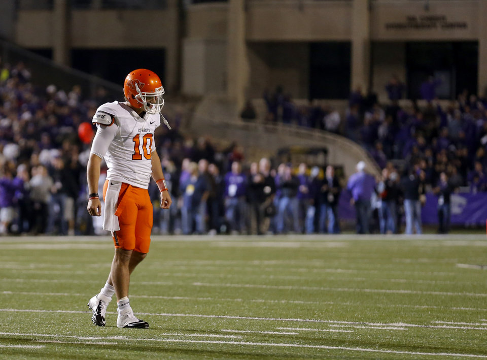 Photo - Oklahoma State's Clint Chelf (10) reacts after throwing an interception late in the fourth quarter of the college football game between Kansas State University (KSU) and Oklahoma State (OSU) at  Bill Snyder Family Football Stadium in Manhattan, Kan.,  Saturday, Nov. 3, 2012. Photo by Sarah Phipps, The Oklahoman