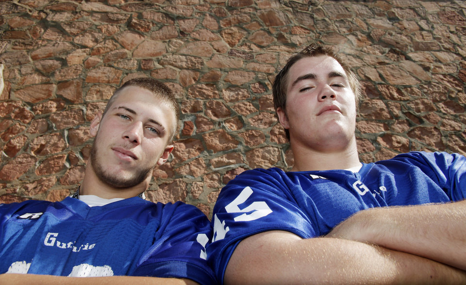 Photo - GUTHRIE HIGH SCHOOL FOOTBALL: Guthrie's Dynamic Duo of quarterback Bryan Dutton, left, and linebacker Landry Chappell will