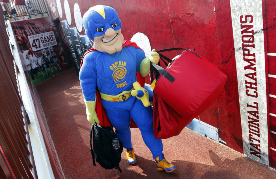 The Tulsa mascot makes his way to the field during the college football game between the University of Oklahoma Sooners (OU) and the University of Tulsa Hurricanes (TU) at the Gaylord-Family Oklahoma Memorial Stadium on Saturday, Sept. 14, 2013 in Norman, Okla. Photo by Chris Landsberger, The Oklahoman